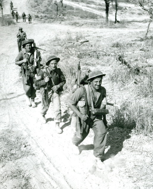 Canadian troops advance towards Italy's Melfa River, May 1944. [PHOTO: CAPT. ALEX STIRTON, LIBRARY AND ARCHIVES CANADA—PA132878]