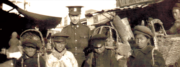 Private Edwin Stephenson poses with some boys at Vladivostok in 1919. [PHOTO: STEPHENSON FAMILY COLLECTION]