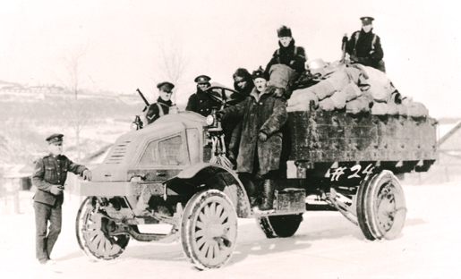 A loaded transport truck provides a photo op for members of the Canadian Siberian Expedition Force, May 1919. [PHOTO: RAYMOND GIBSON, LIBRARY AND ARCHIVES CANADA—C091749]